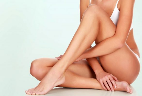 Young woman with slim body and smooth clean skin